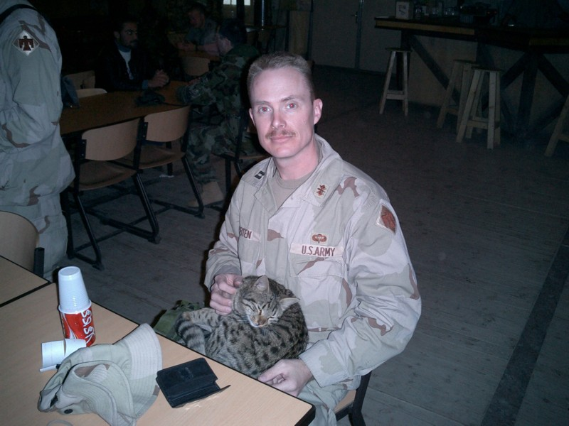 Soldier with cat on lap