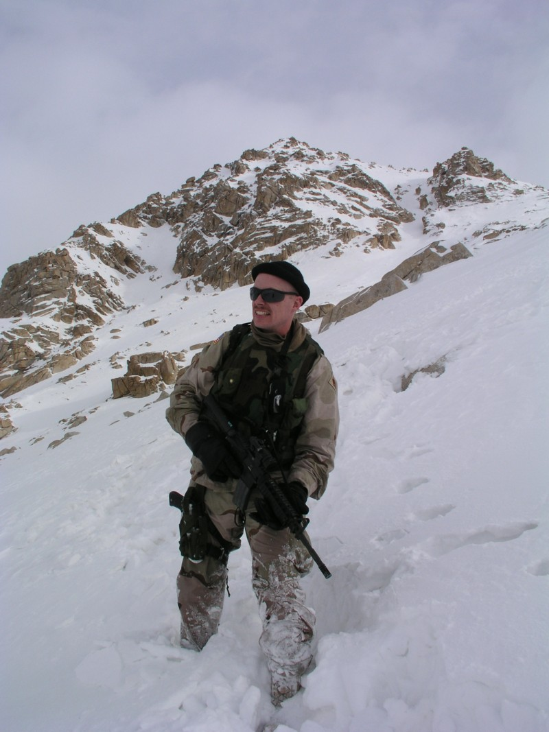 Soldier up to his knees in snow in the Salang Mountains